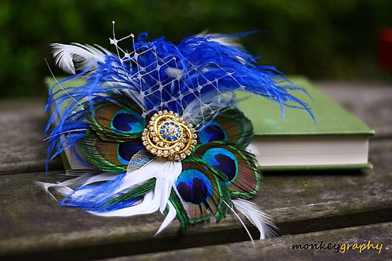 For an extra luxe look pair peacock feathers with interesting and detailed