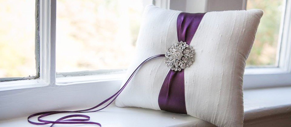 Ring Pillow with purple satin ribbon accent - Photo by Lacey Claire Designs | Etsy Wedding Team