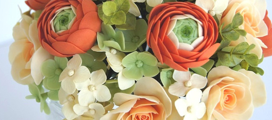 Etsy Wedding Team. Ranunculus bouquet in orange. Photo by Parsi flowers